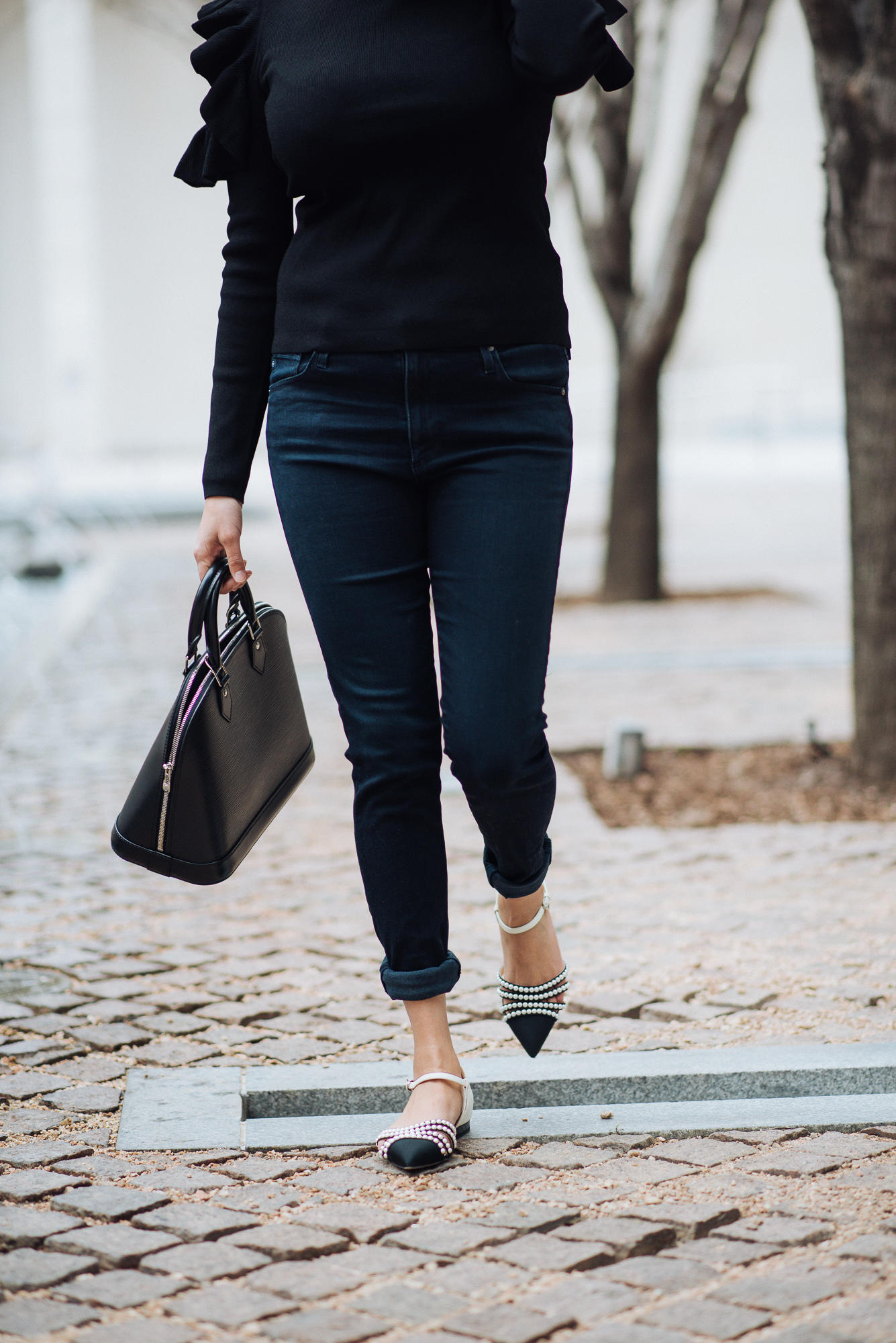 Image of all black everything | The cultured fashionista | Club Monaco Top | Louis Vuitton Alma | All Black Outfit Ideas